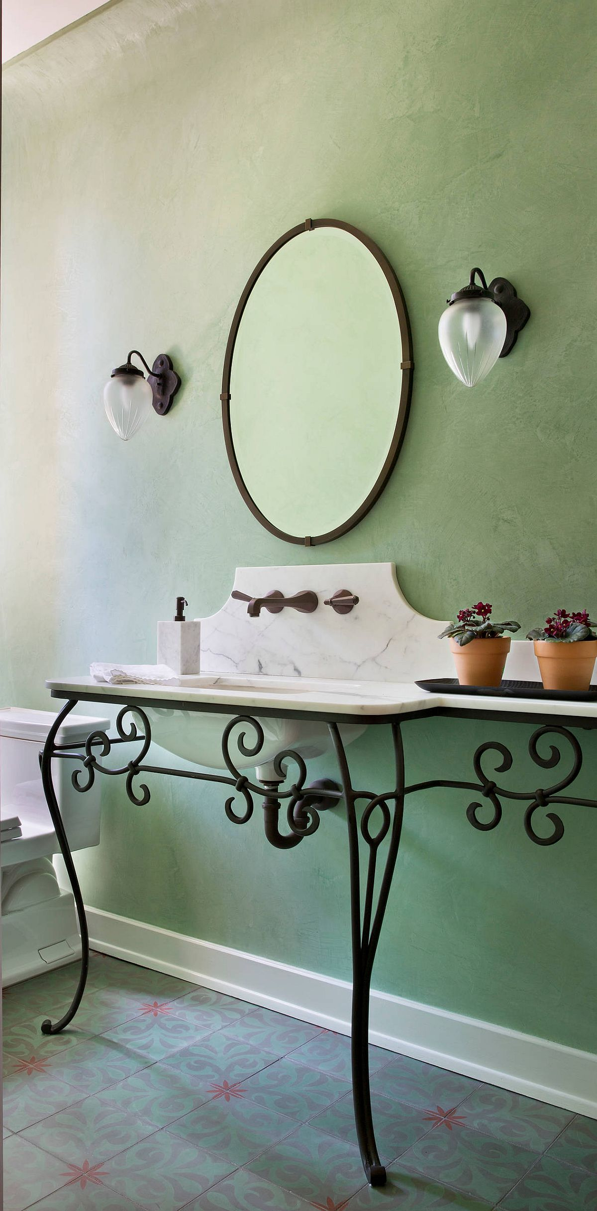 Green lends itself beautifully to a wide variety of styles in the powder room including Mediterranean