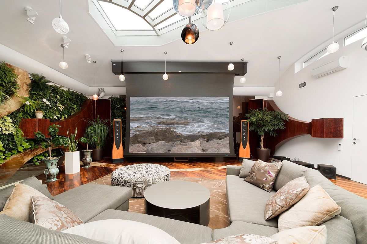 Green wall brings both freshness and color to the modern eclectic home theater in white