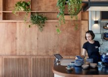 Greenery-brings-life-to-the-raw-concrete-wood-and-rammed-earth-restaurant-interior-58677-217x155