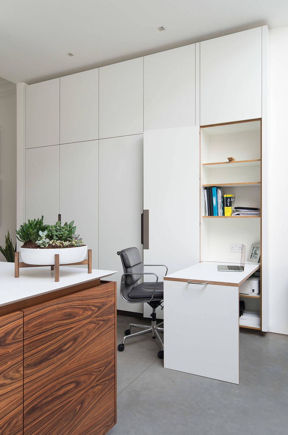 Innovative folding desk inside this London home office dissappears into the walls when not in use!