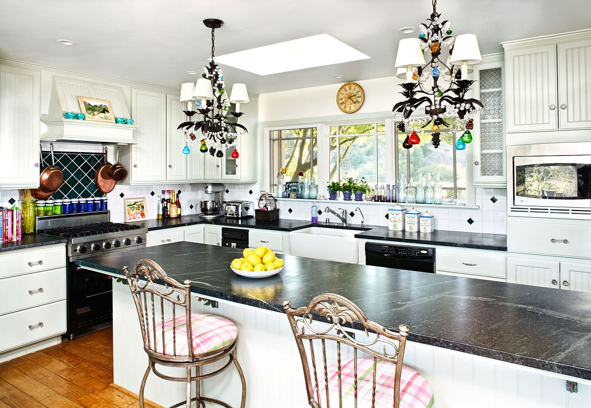 It is easy to notice the beautiful use of black appliances in this white Santa Monica Kitchen