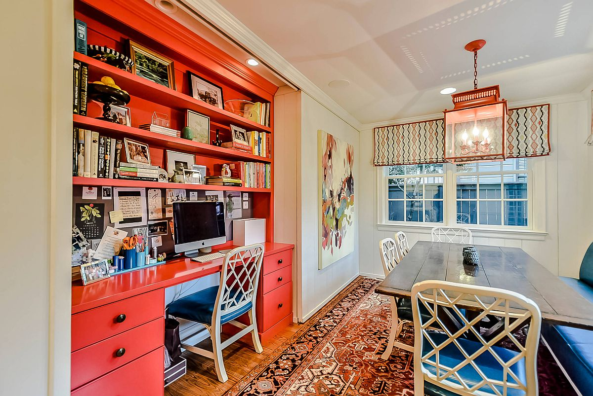 It is hard to miss the bright orange work station in this breakfast room