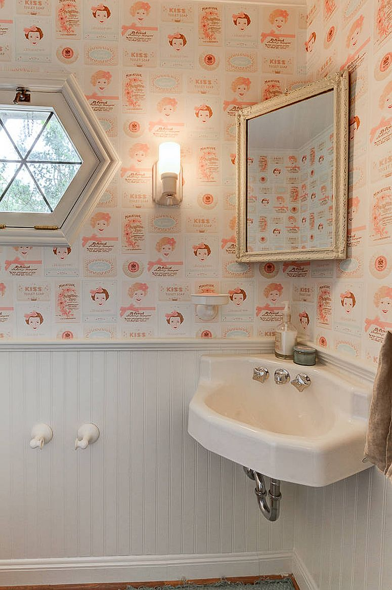 It is the wallpaper that steals the show in this white powder room