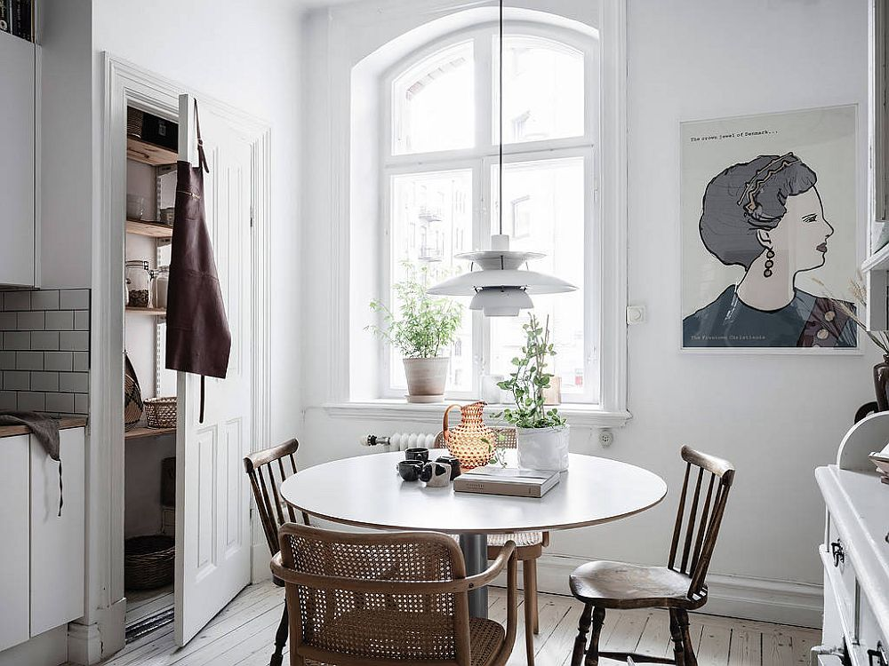 Keeping things simple and eclectic in the tiny Scandinavian style dining area inside Gothenburg apartment