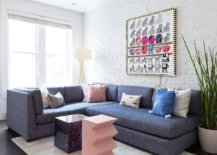 Large-bluish-gray-sectional-for-the-white-living-room-with-painted-brick-wall-92154-217x155