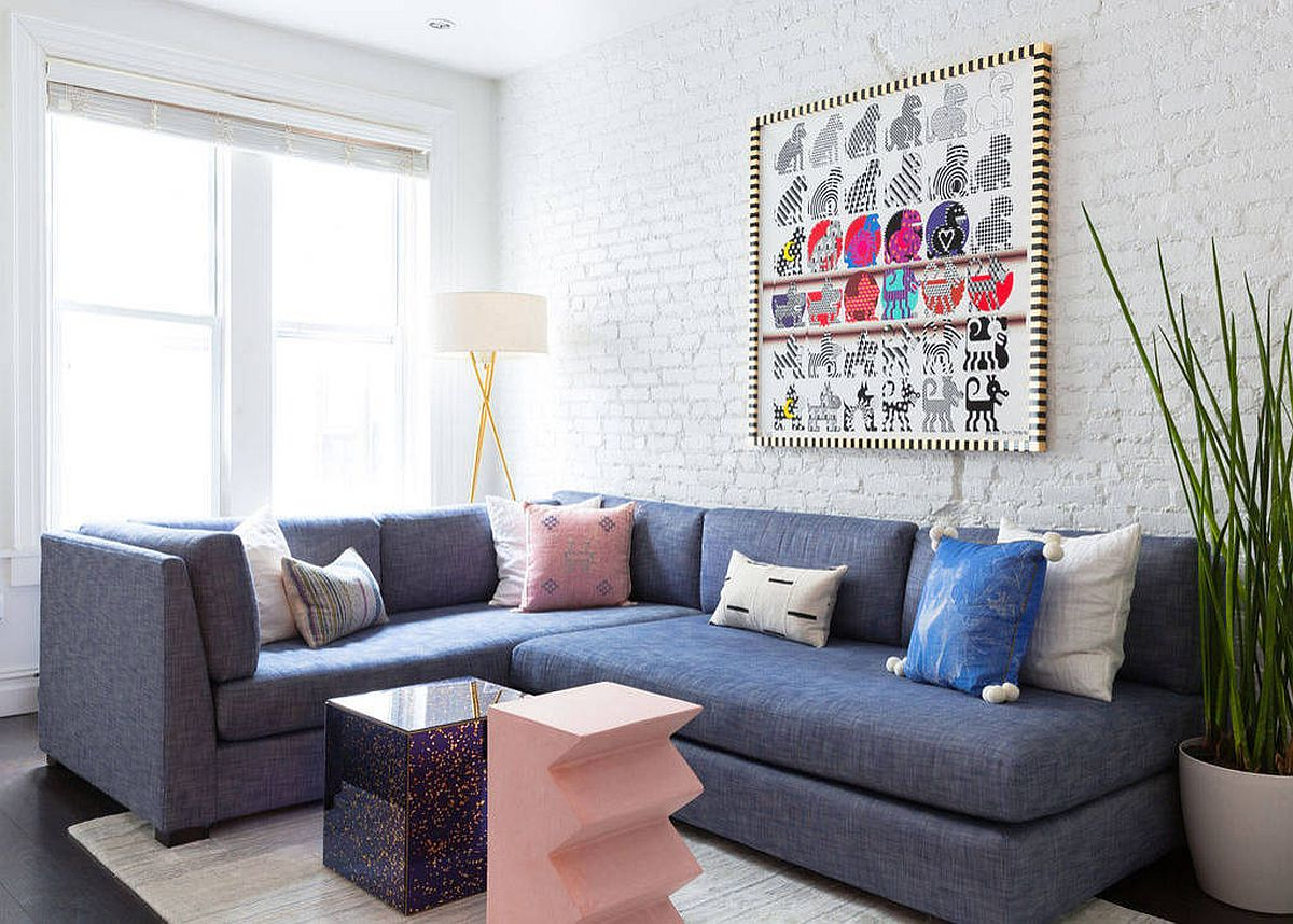 Large-bluish-gray-sectional-for-the-white-living-room-with-painted-brick-wall-92154