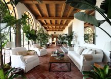 Lavish-sunroom-and-living-room-with-terra-cotta-floor-and-ample-greenery-53669-217x155