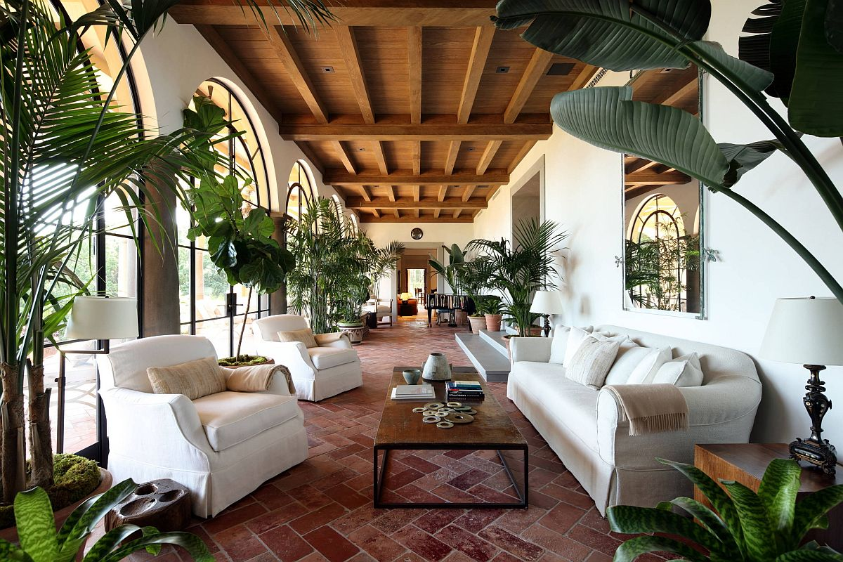 Lavish-sunroom-and-living-room-with-terra-cotta-floor-and-ample-greenery-53669