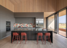 Light-dark-and-wooden-elements-intertwined-beautifully-in-the-spacious-kitchen-15646-217x155
