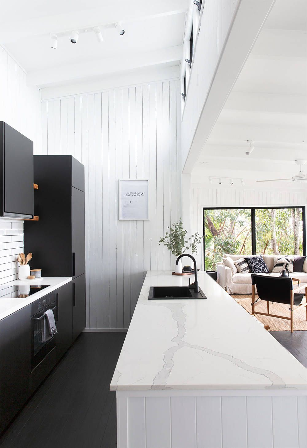 Light-filled beach style kitchen in black and white
