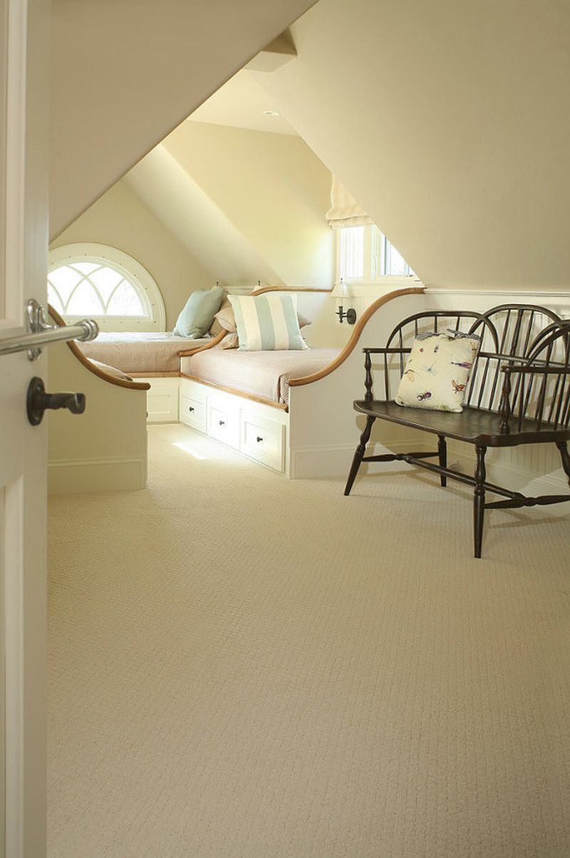 Lovely bed frames, color of the room and the accent pillows all combine to create an understated beach style in his attic bedroom