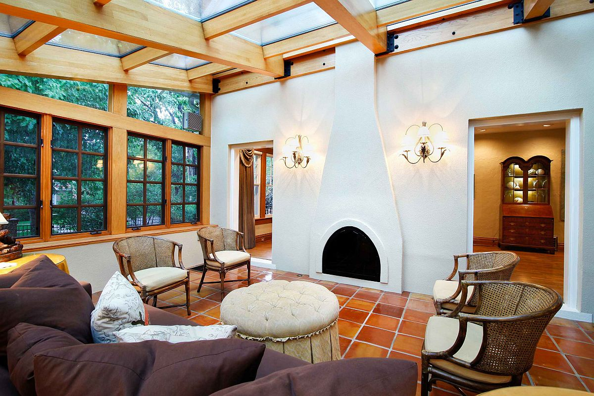 Mediterranean-style-living-room-with-white-walls-terracotta-flooring-and-a-glass-celing-85254