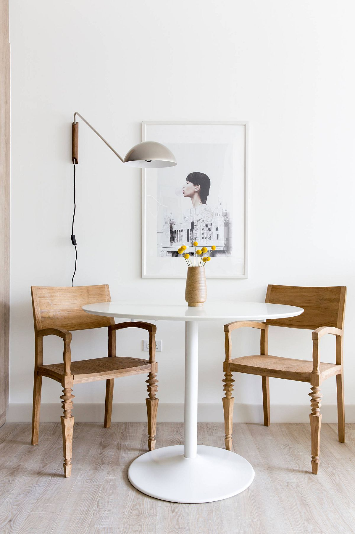 Minimal-Scandinavian-style-dining-room-with-two-chairs-and-sconce-lighting-51980
