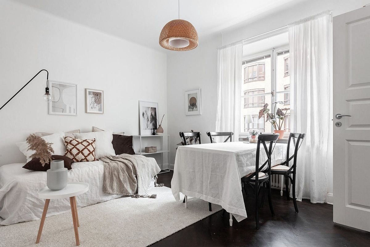 Modern-living-area-and-dining-room-of-Stockholm-apartment-keeps-things-elegant-and-simple-45266