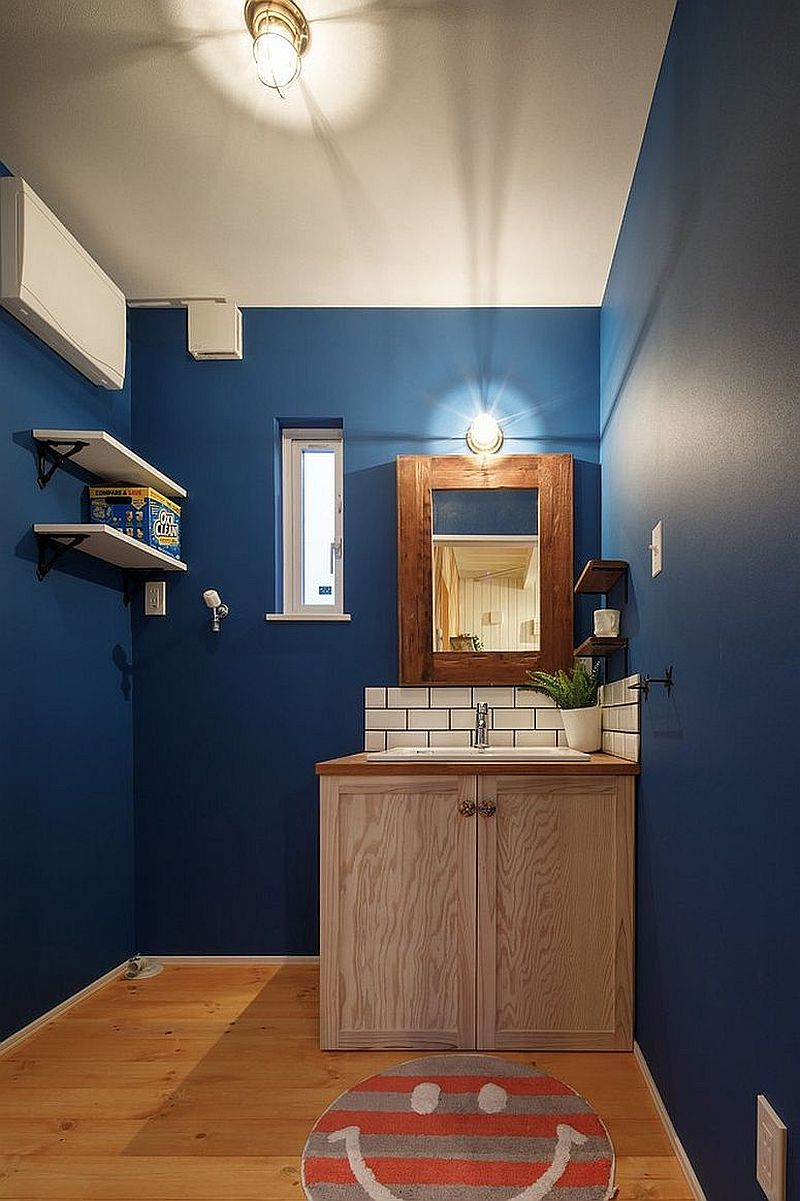 Navy blue and white combned in the spacious modern powder room with ease