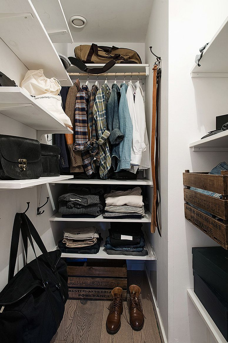 Open shelves for the space-savvy closet inside the modern apartment bedroom