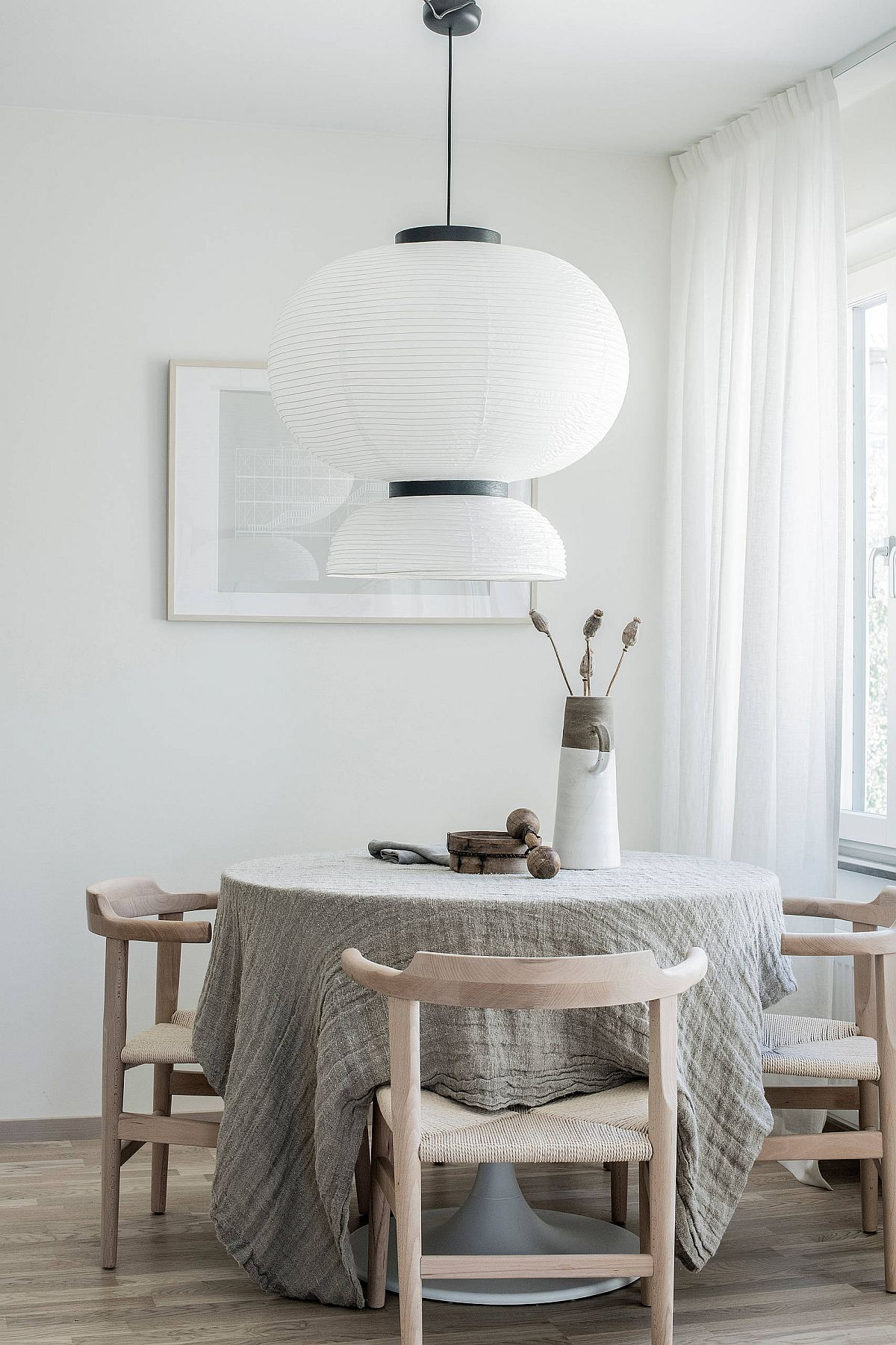Oversized-pendant-for-the-tiny-dining-area-in-white-33441