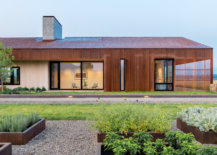Oxidized-metal-wood-and-glass-shape-the-exterior-of-the-asymmetrical-Dogtrot-House-87002-217x155