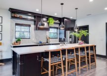Pre-finished-dark-hardwood-floor-for-the-contemporary-kitchen-with-gorgeous-lighting-and-black-cabinets-44467-217x155