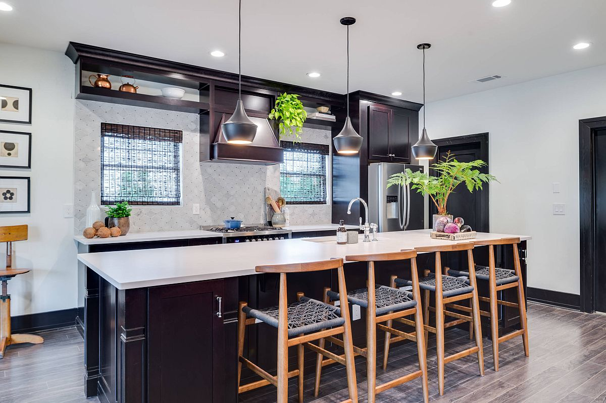 Pre finished dark hardwood floor for the contemporary kitchen with gorgeous lighting and black cabinets
