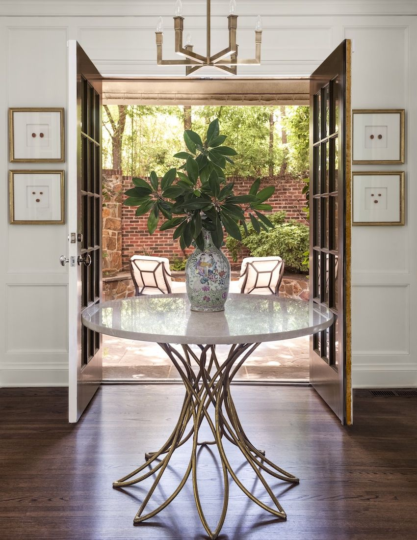 Round-entryway-table-with-a-vase-arrangement-79513