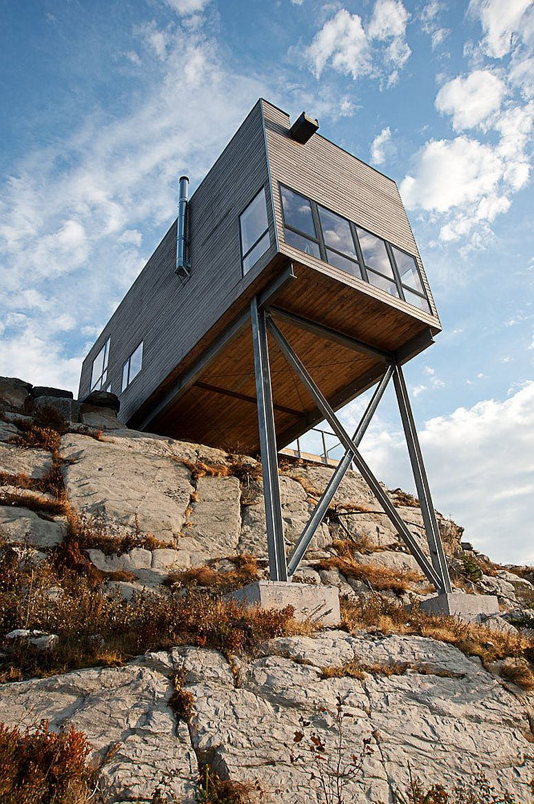 Rustic retreat on the edge of a cliff is cantilevered above the rocks in a thrilling fashion