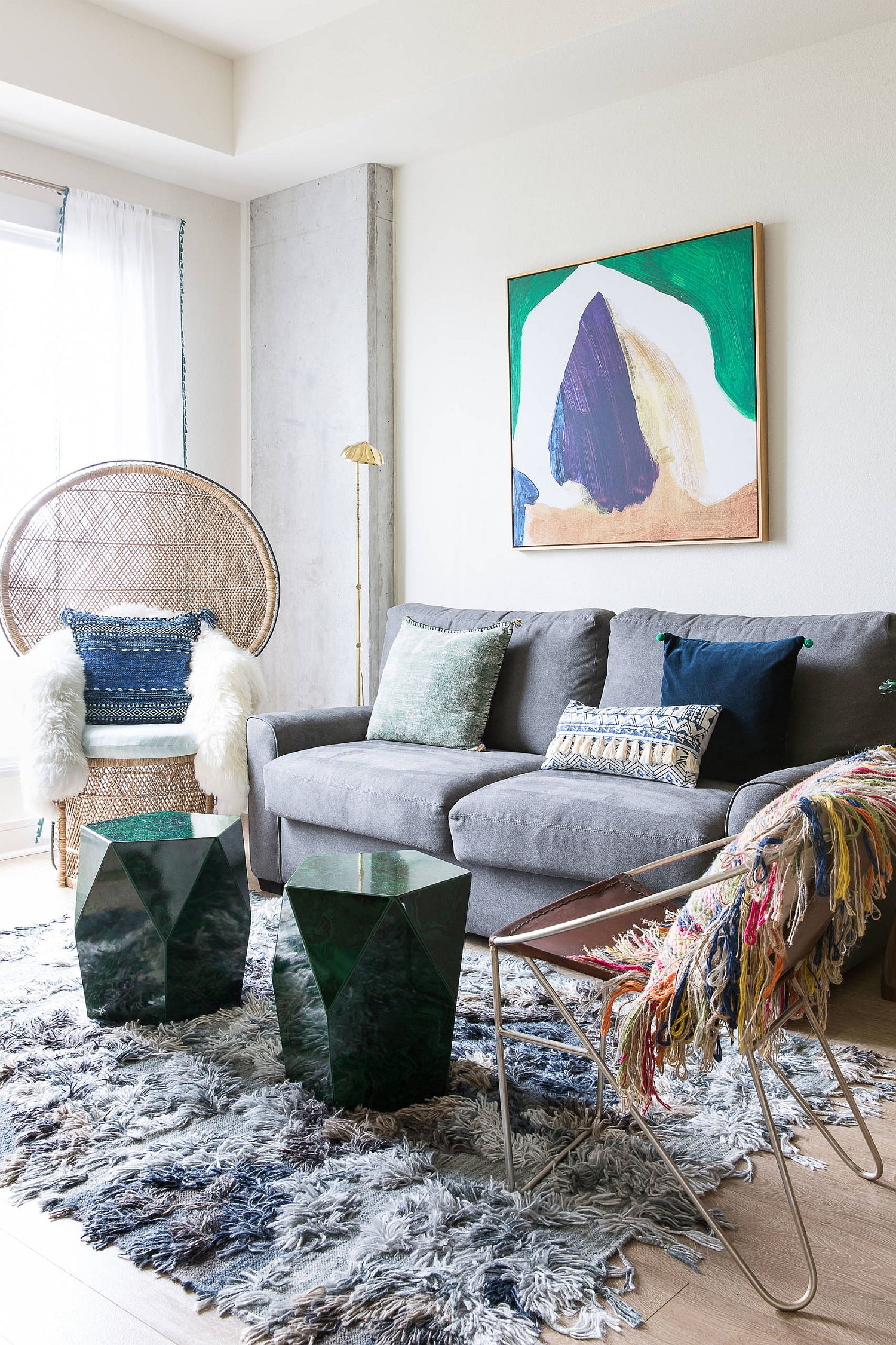 Sculptural side tables and the Peacock chair take a place of prominence in this living room