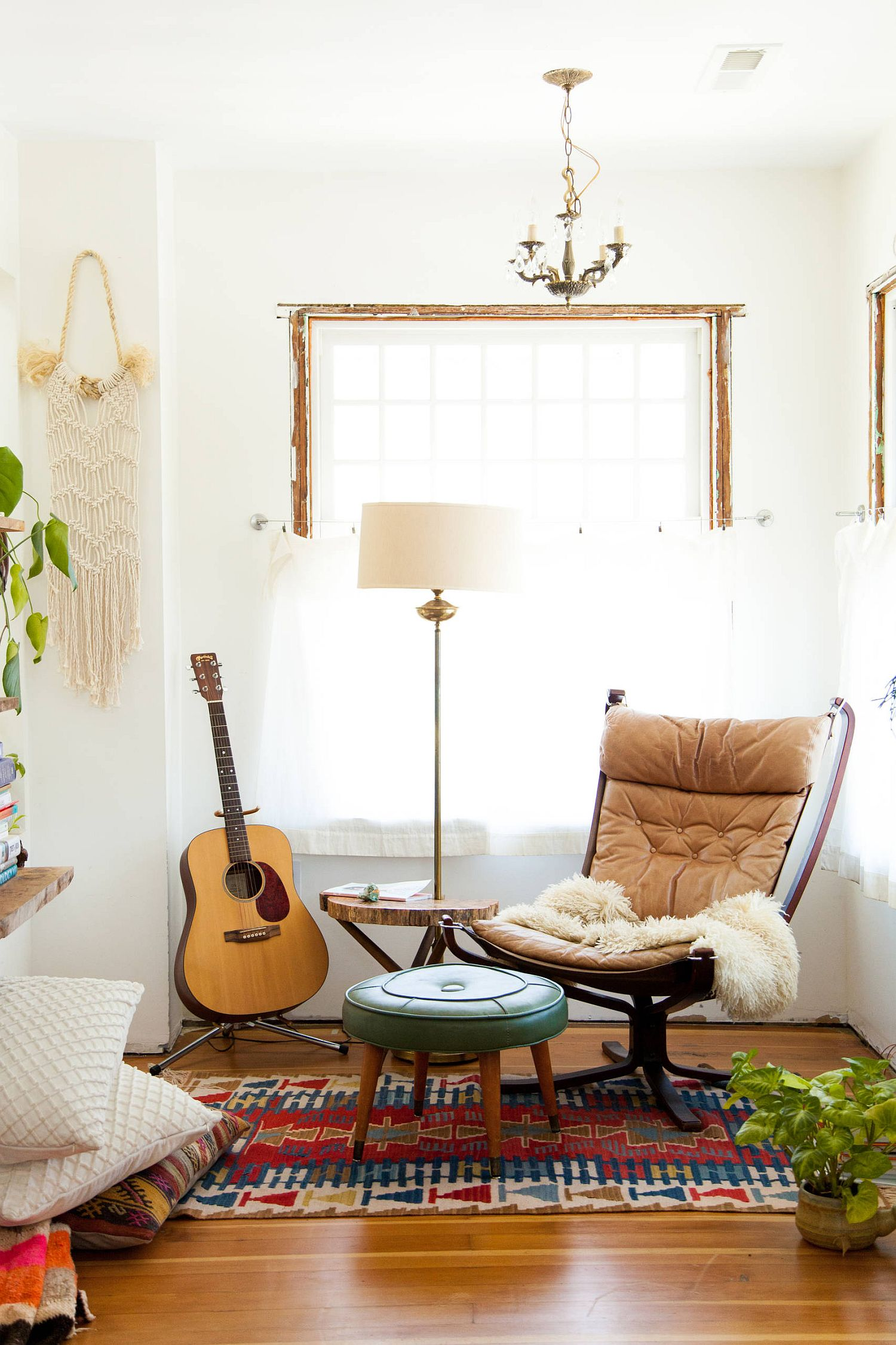 Serene white backdrop coupled with some 1970's vintage charm for the relaxing retro living room