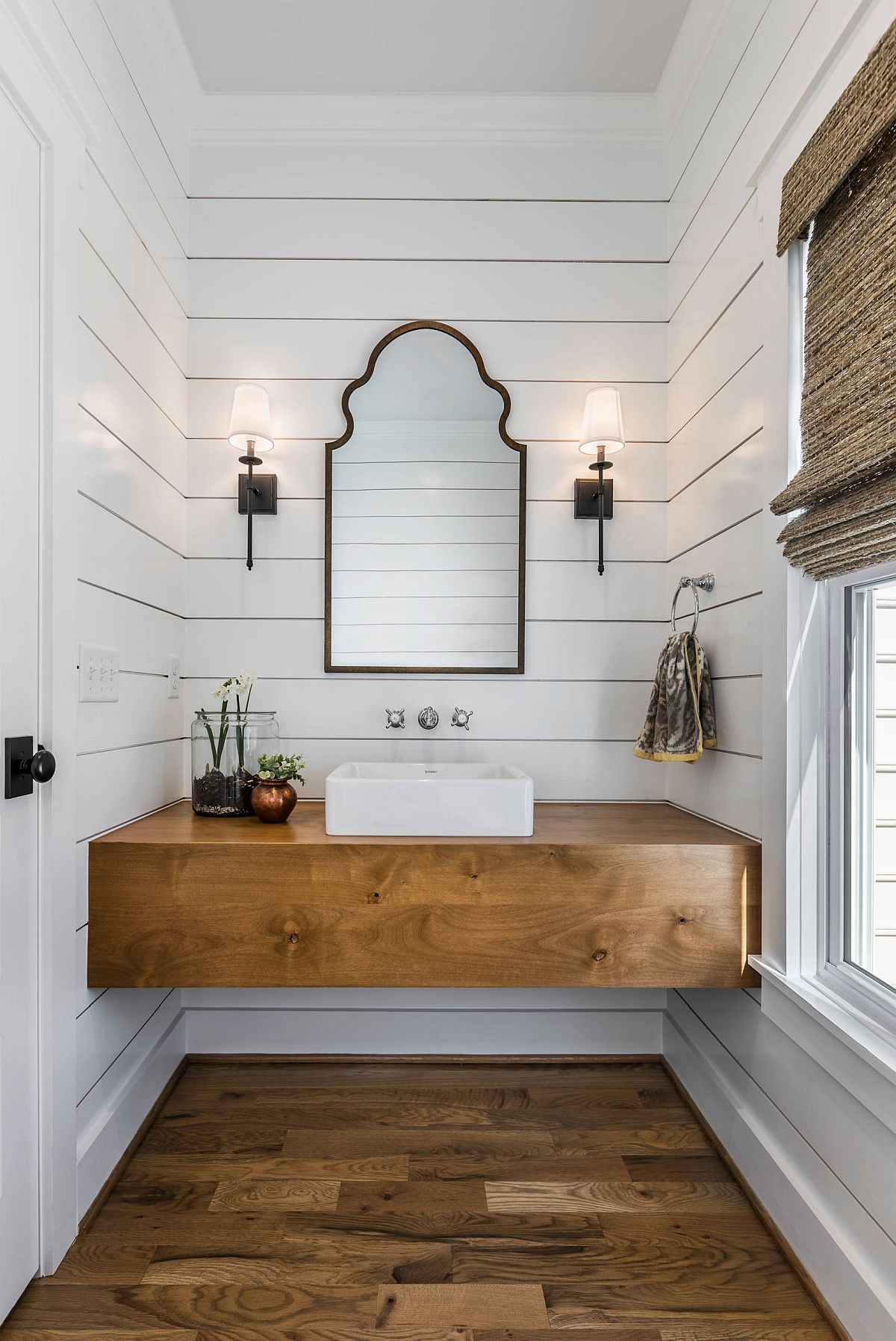 Simple and elegant farmhouse style powder room makes smart use of space