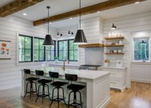 Simple-and-modern-use-of-wooden-ceiling-beams-along-with-floating-wooden-shelves-in-the-white-kitchen-23609-217x155