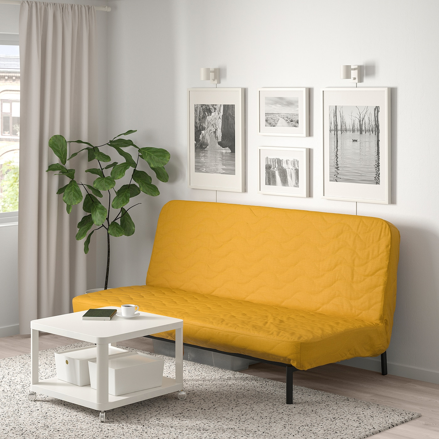 Sofa bed with a bright yellow cover