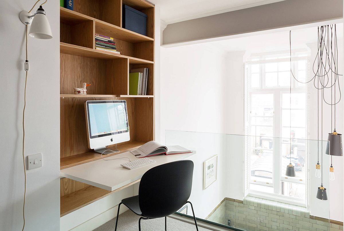 Space-savvy home office design in the staircase landng area with a floding work desk