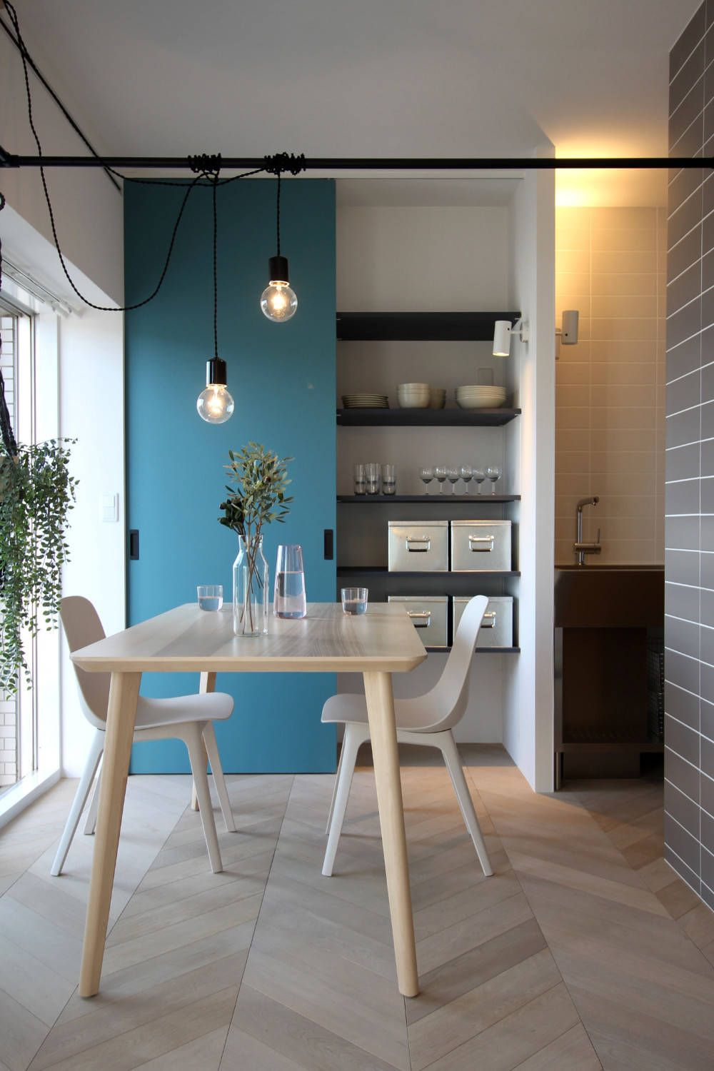 Storage-wall-with-sliding-door-in-the-backdrop-adds-blue-to-the-small-dining-room-54367