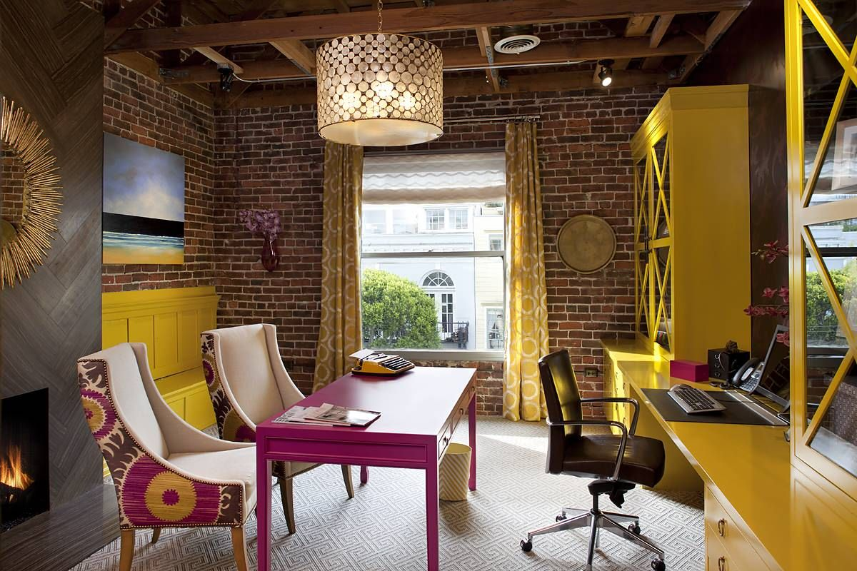 Stunningly gorgeous home office with brick walls combines yellow, pink and eclectic dazzle