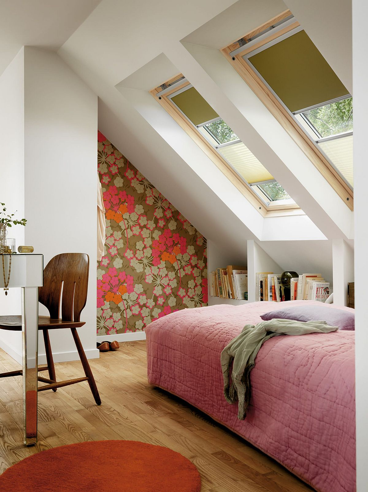 This little attic bedroom comes with a cool workspace as well!