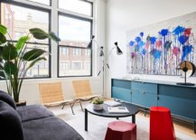 Tiny-Scandinavian-style-living-room-with-gray-couch-and-blue-credenza-35240-217x155