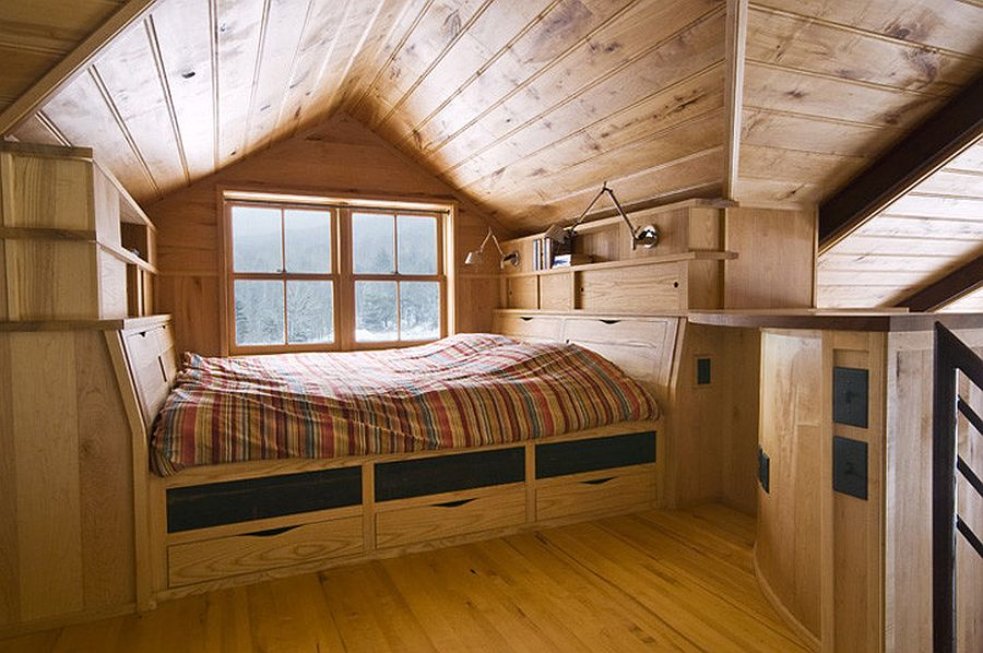 Tiny attic bedroom comes with ample storage space under the bed