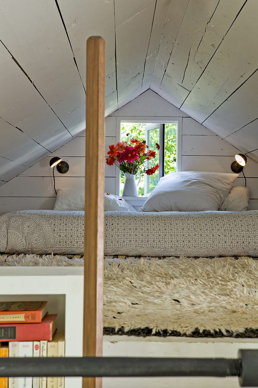 Tiny shabby chic loft bedroom inside the small home is a necessity rather than a luxury!
