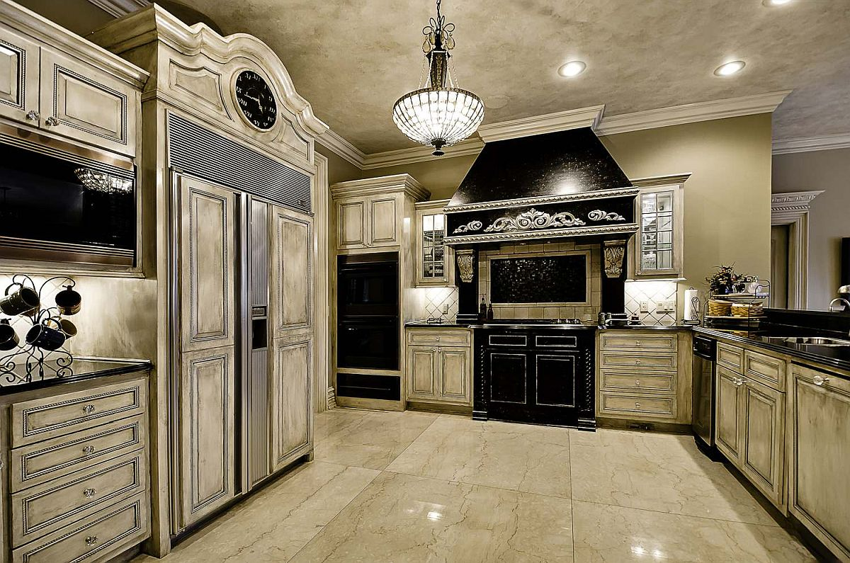 Traditional kitchen in stone with textured walls and black appliances