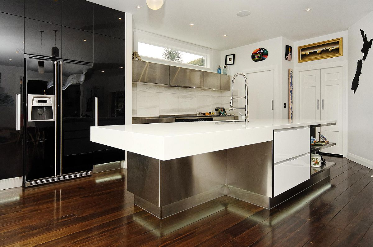 Trendy contemporary kitchen in white with high gloss black appliances and cabinetry
