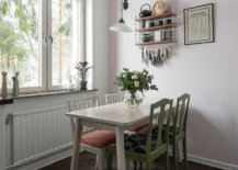Twin-chairs-add-green-glam-to-the-white-dining-area-63834-217x155