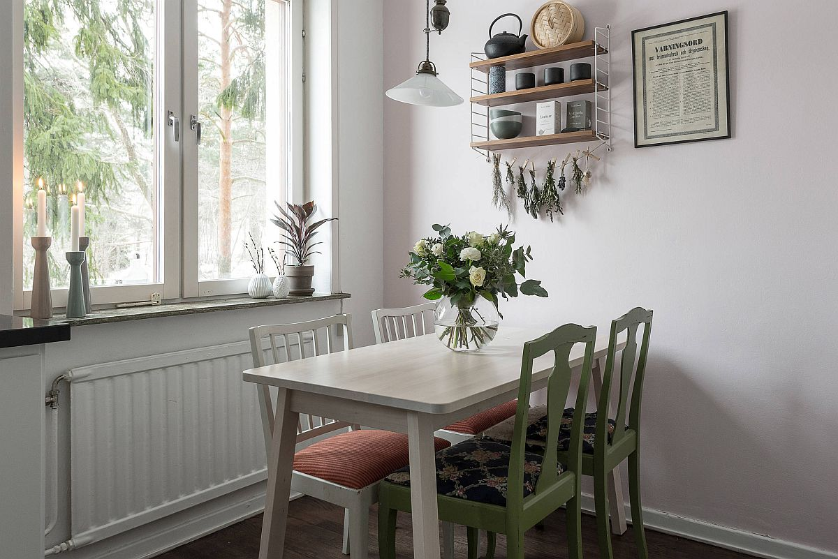Twin-chairs-add-green-glam-to-the-white-dining-area-63834