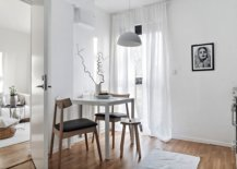 White-Scandinavian-dining-room-makes-us-eof-limited-space-on-offer-while-being-flooded-by-natural-light-91065-217x155