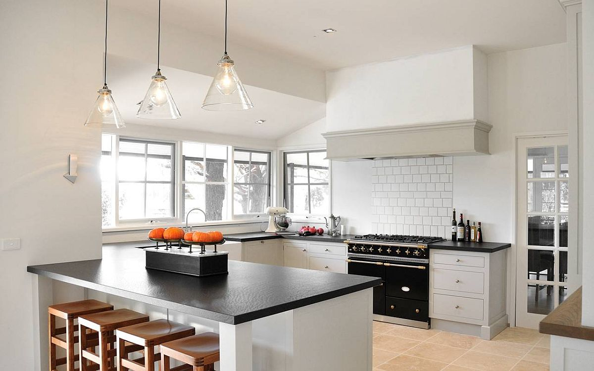 White walls and cabinetry of custom farmhouse kitchen in Melbourne allow the black appliances to make a bigger impact
