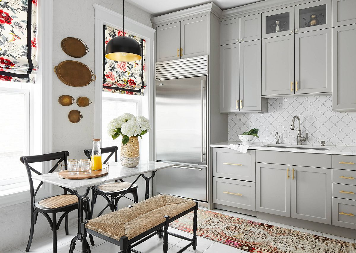 Window covering are an easy way to bring flowery beauty to this white and gray eat-in kitchen