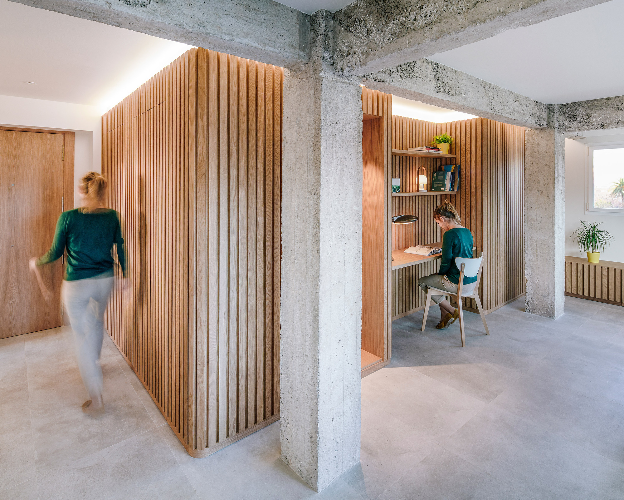 Wood and concrete find space next to one another inside this space-savvy modern Spanish apartment