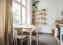 Wood-and-white-kitchen-and-dining-area-with-serene-Scandinavian-style-28897-217x155