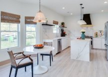 Wooden-floor-in-lighter-tone-gives-the-modern-kitchen-a-much-more-brighter-light-filled-visual-appeal-59960-217x155