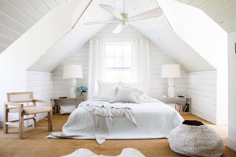 You just cannot go wrong with white when it comes to beach style attic bedrooms
