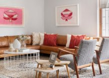 Accent-pillows-in-orange-and-cream-give-the-room-a-balanced-look-71119-217x155